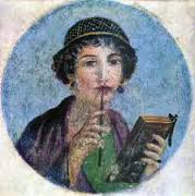 Fresco of a woman with a pen at her lip as if she's thinking about what to write.